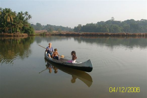 pirkko-and-kids-canoeing-down-the-lake-olaulim.jpg